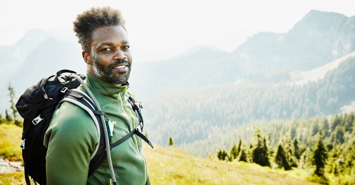 Portrait of veteran on hike in mountains