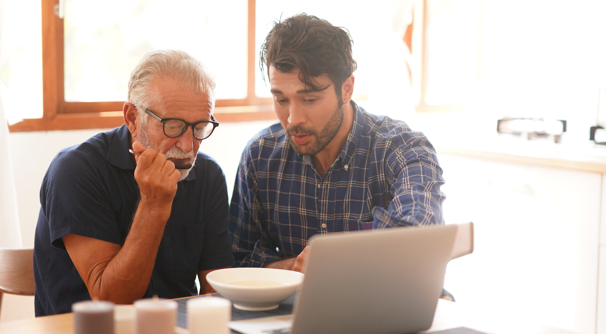 Two men looking at computer