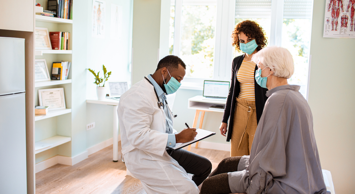 Woman and caretaker at doctor appointment