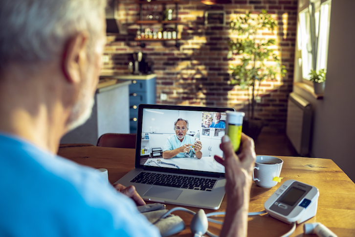 Man visiting with doctor on telehealth visit