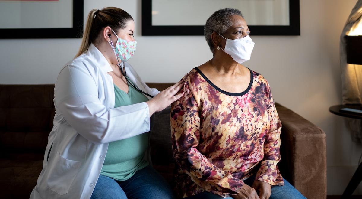 Healthcare worker listening to patient's heart