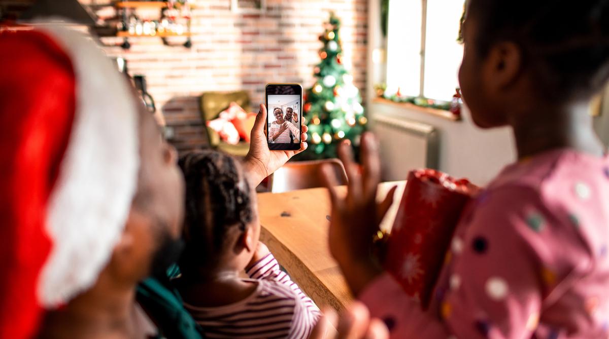 Family sharing virtual holiday celebration