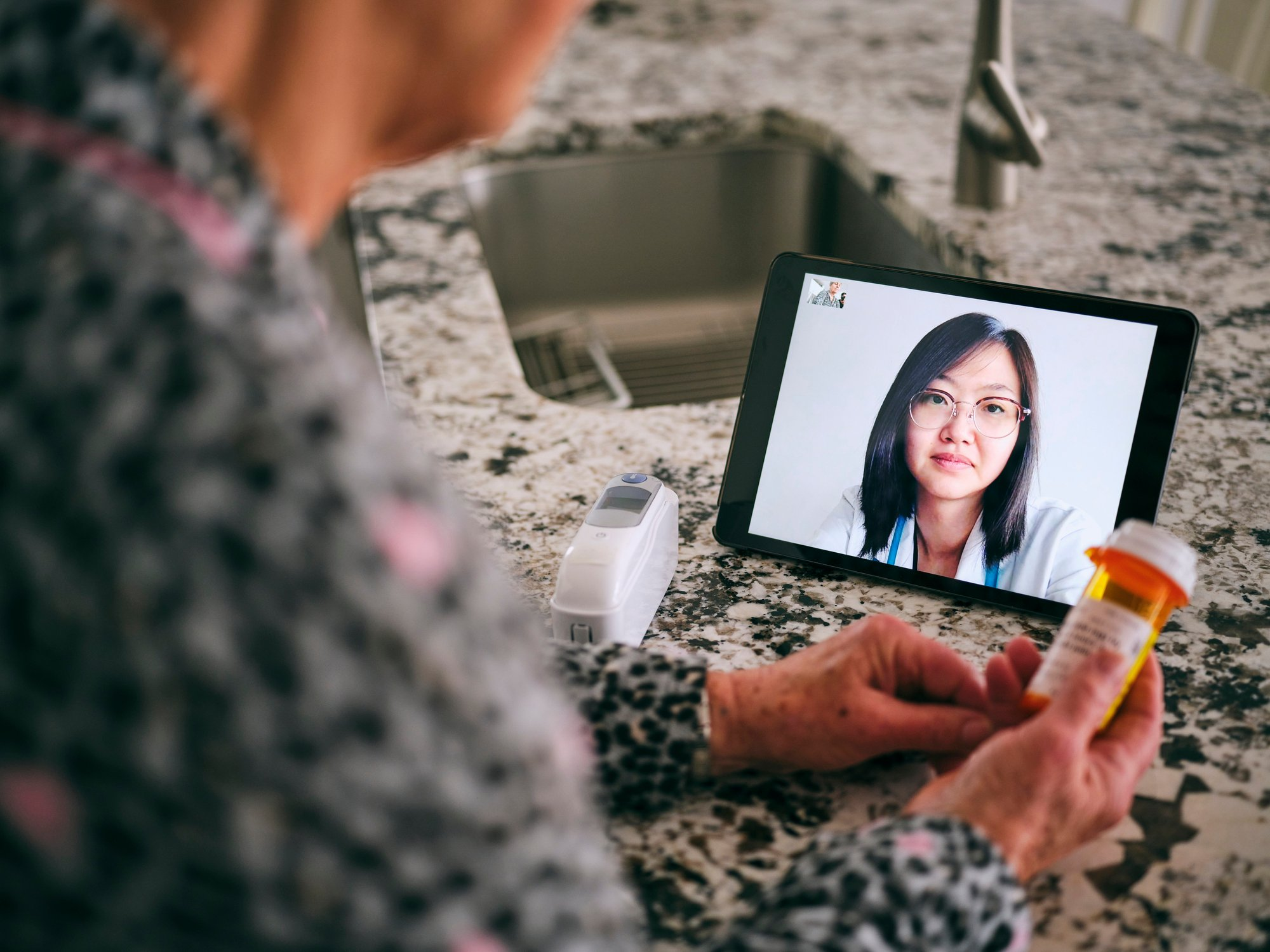 Patient with doctor on telehealth appointment