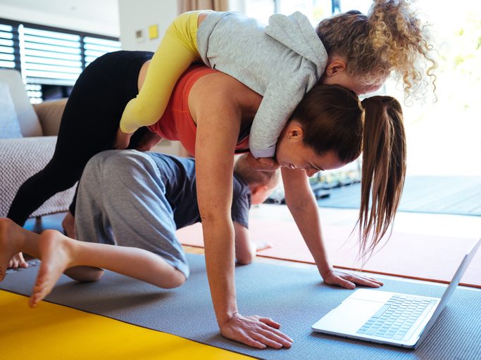 Home workout mom multitasking