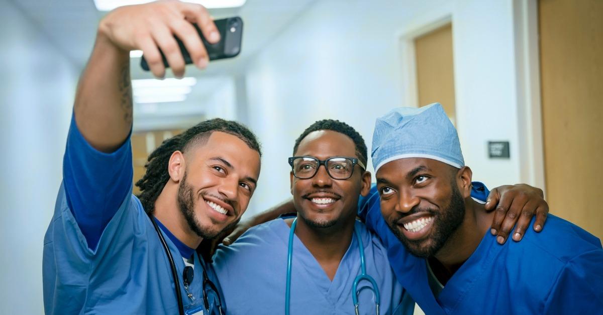 Smiling nurses posing for social media selfie
